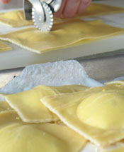Place Ravioli on Corn Meal Covered Parchment Paper